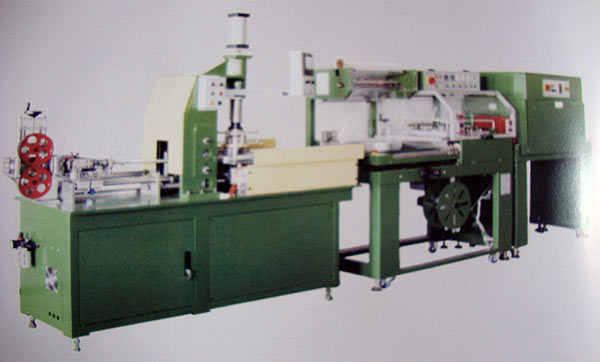 Photo of an Automated Coiling Machine with Wrapping and Shrinking Oven